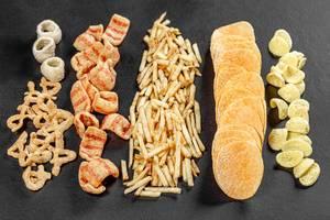 Set of potato snacks and chips on black background (Flip 2019)