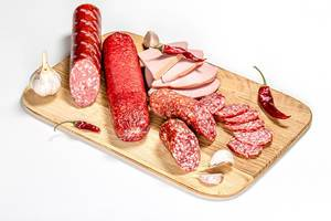 Set smoked salami and sausage on a wooden kitchen Board (Flip 2020)