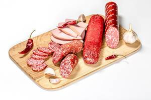 Set smoked salami and sausage on a wooden kitchen Board