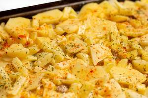 Shallow focus on raw potatoes moussaka ready for baking