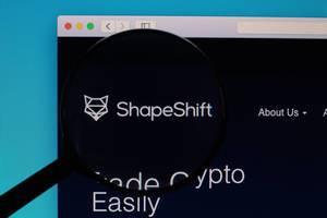 ShapeShift logo under magnifying glass