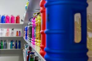 Shelf with plastic sport bottles of different shapes, sizes and colors - FIBO Cologne 2018