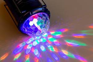 Shines a flashlight with colored rays