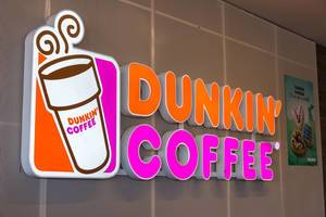 Shining neon advertising sign of the Dunkin