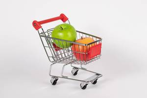 Shopping cart filled with fresh apples