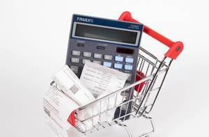 Shopping cart with Receipts and calculator on white background