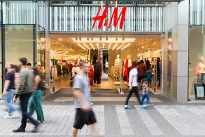 Shopping street with H&M store front