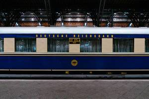 Sideview of antique Reichsbahn blue passenger car (carriage)