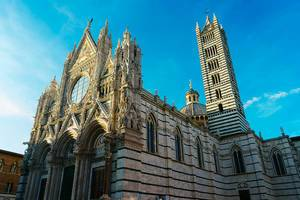 Siena Cathedral Duomo di Siena on a beautiful sunny day with blue sky in Siena, Italy
