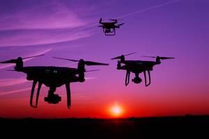 Silhouette of drones in the sky (Flip 2019)
