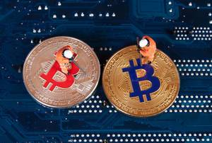 Silver and Golden Bitcoin with two miners
