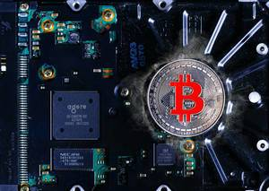 Silver Bitcoin on a background of computer mining electronic parts