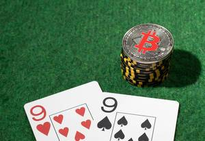 Silver Bitcoin on the poker table with chips