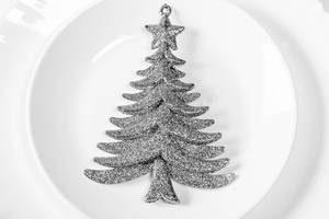Silvery Christmas tree decor on white plate (Flip 2019)