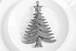 Silvery Christmas tree decor on white plate