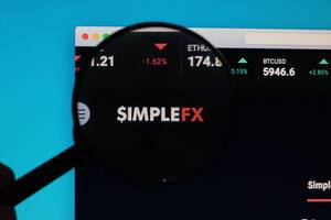 SimpleFX logo under magnifying glass