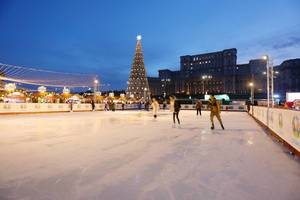 Skate rink at Bucharest Christmas market, The Palace of Parliament on background (Flip 2019)