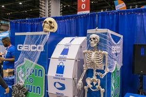 Skeleton and skull at a spin to win game by at North Building of the McCormick Place Convention Center