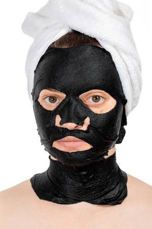 Skin care face concept- black mask on face women