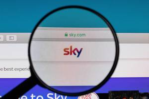 SKY logo under magnifying glass