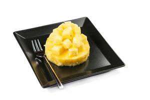 Sliced and served Pineapple on the plate