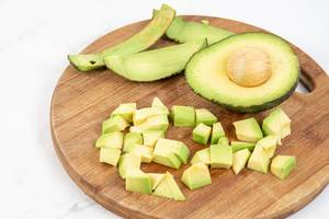 Sliced Avocado on the kitchen cutting board