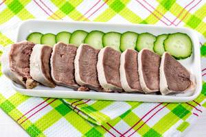 Sliced boiled tongue with cucumbers