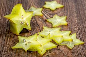 Sliced carambola fruit on wooden background