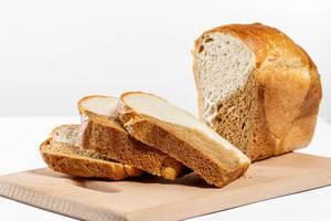 Sliced fresh bread on white background