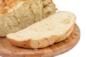 Sliced Fresh Corn Bread on the wooden board (Flip 2019)