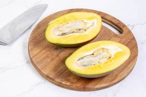 Sliced Fresh healthy Mango fruit on the wooden board