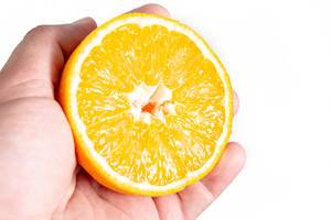 Sliced Half Orange fruit in the hand