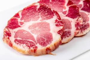 Sliced jerky pork meat on a white background (Flip 2020)