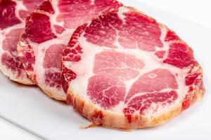 Sliced jerky pork meat on a white background