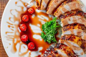 Sliced juicy, tender chicken breast grill close-up.