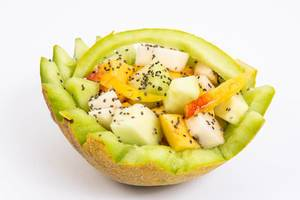 Sliced Melon and Peach with Chia seeds above white background