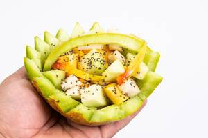 Sliced Melon and Peach with Chia seeds in the hand