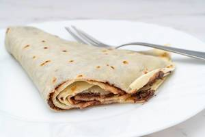 Sliced Pancake with Chocolate on the plate (Flip 2019)