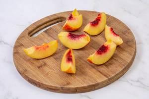 Sliced Peach on the round wooden board (Flip 2019)