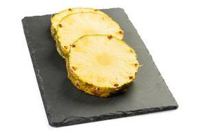 Sliced Pineapple on the black tray