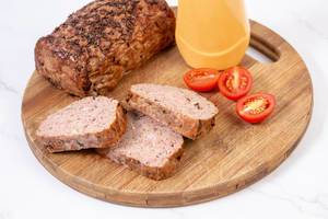 Sliced Pork and Chicken Meat Loaf with Tomatoes on the board (Flip 2019)