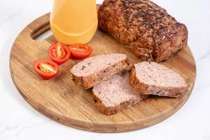 Sliced Pork and Chicken Meat Loaf with Tomatoes on the board