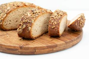Sliced Protein Bread with Pumpkin seed on the wooden board (Flip 2019)