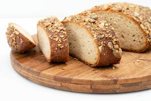 Sliced Protein Bread with Pumpkin seed on the wooden board