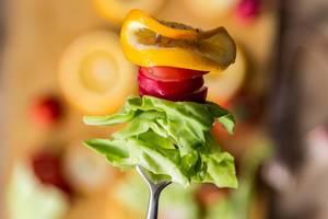 Sliced radish, cabbage, and lemon on the fork (Flip 2019)
