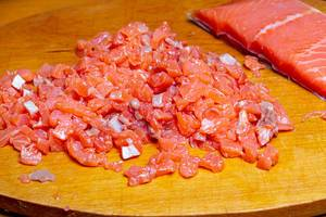 Sliced salmon fillet on a wooden kitchen Board (Flip 2020)