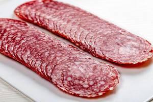 Sliced smoked sausage, close up (Flip 2019)