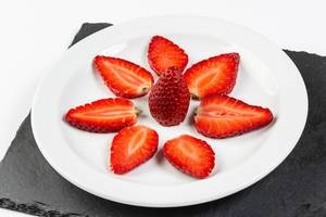 Sliced Strawberries served on the plate (Flip 2019)