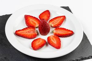 Sliced Strawberries served on the plate