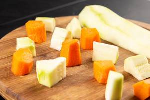 Sliced Zucchini and Carrots on the cutting board